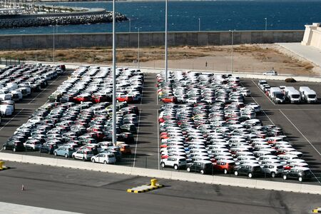 new motor vehicles: New motor vehicles parked together at the Port of Valencia, Spain