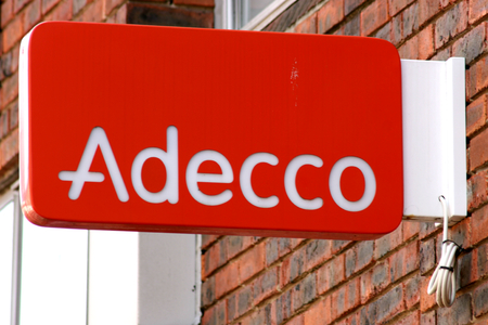 employment agency: Adecco employment agency sign, High Street, Chelmsford, Essex, England Editorial