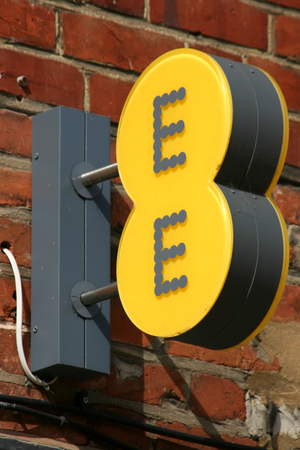 ee: EE mobile phone shop sign, High Street, Chelmsford, Essex, England
