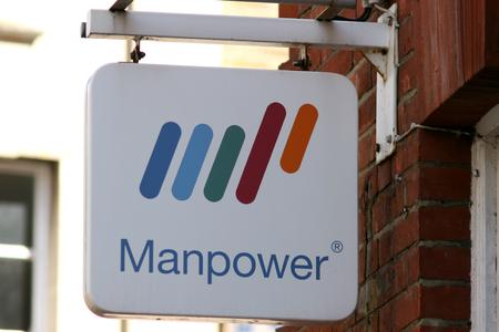 manpower: Manpower employment agency sign, High Street, Chelmsford, Essex, England