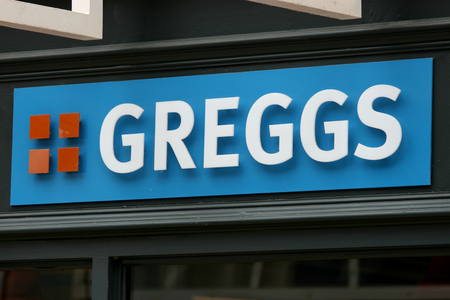 Greggs bakery shop sign in George Yard in Braintree Essex England Editorial