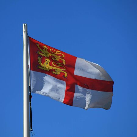 sark: Flag of Sark in the Channel Islands Stock Photo