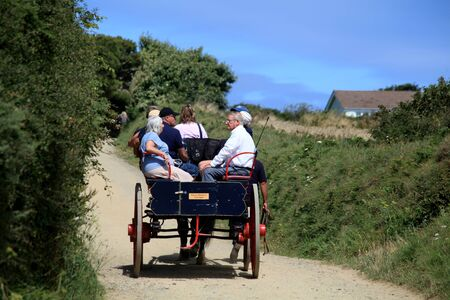 Horse drawn carraige takes tourists around Sark in the Channel Islands Editorial