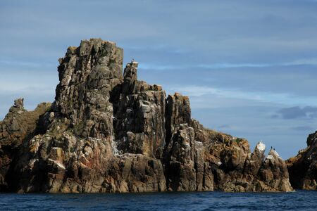 sark: The rocky costline seen from the sea of Sark in the Channel Islands