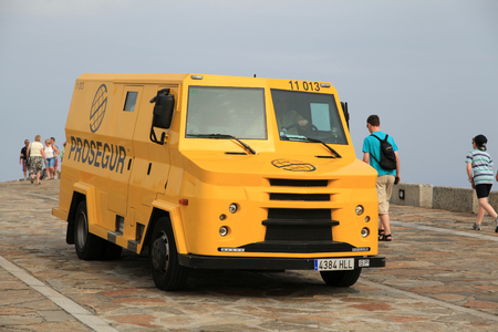 valuables: Modern day security van leaving The Tower of Hercules lighthouse, A Coruna, Spain