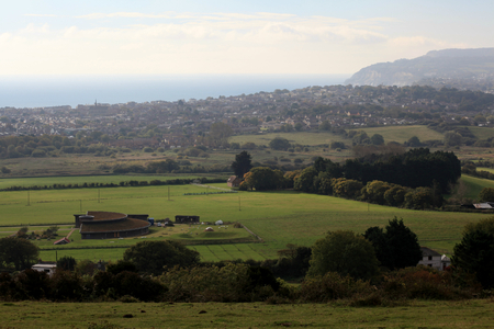 isle: Brading Roman Villa museum and Sandown, seen from the Brading Downs, Isle of Wight