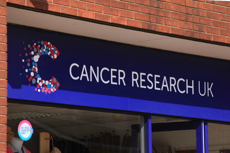 cancer research: Cancer Research shop sign, High Street, Chelmsford, Essex, England Editorial