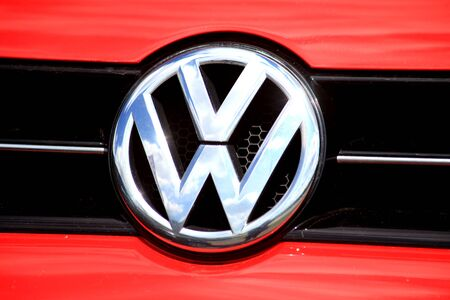 car grill: VW car badge on radiator grill of vehicle