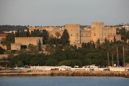 rhodes: Early morning sunshine bathes The Palace of the Grand Master, Rhodes Town, Rhodes, Greece