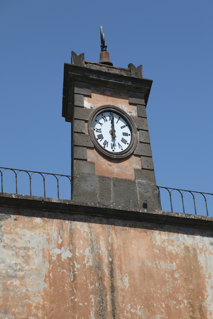tuscania: Clock tower above Porta del Poggio,  Tuscania, Italy Stock Photo