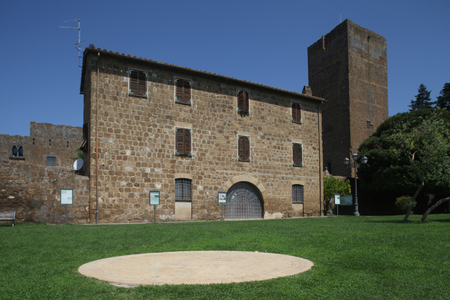 tuscania: Sundial with Palace and Tower of the Lavello family, Tuscania, Italy Editorial