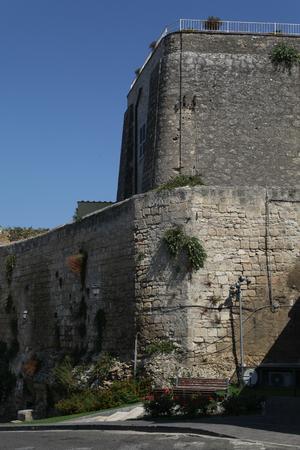 Stone city walls of Tarquinia, Italy Stock Photo