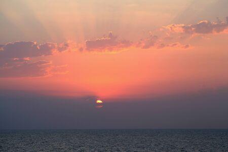 rhodes: Sunrise over the Mediterranean Sea near Rhodes, Greece Stock Photo