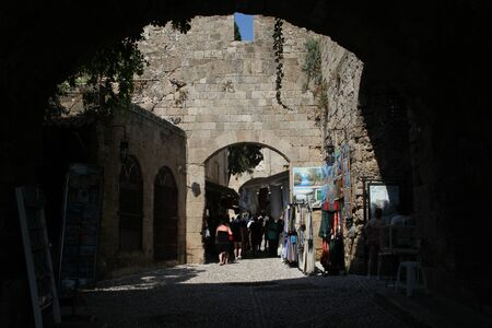 cobbled: Narrow cobbled street  lined with tourist shops in Rhodes Town, Rhodes, Greece Editorial