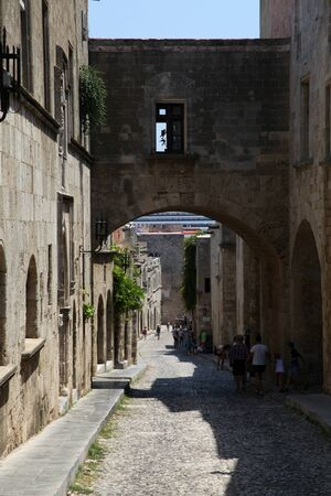 cobbled: Narrow cobbled street in Rhodes Town, Rhodes, Greece Stock Photo