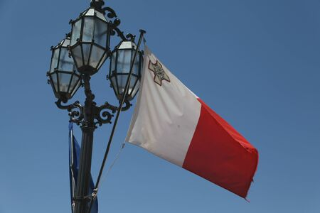 lamp post: Flag of Malta and ornate lamp post, Valletta, Malta