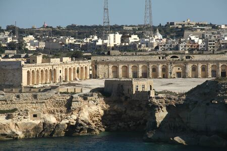 departing: Fort Ricasoli, Kalkara seen from a cruise ship departing from the Grand Harbour, Valletta, Malta Stock Photo