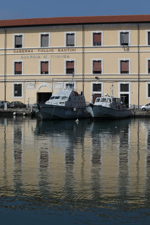 enforcement: Guardia di Finanza or Law Enforcement Agency building with vessels, Livorno, Italy Editorial