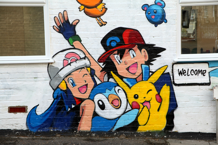 Pokemon Go gym artwork on Head Hunters hairdressers, Springfield Road, Chelmsford, Essex