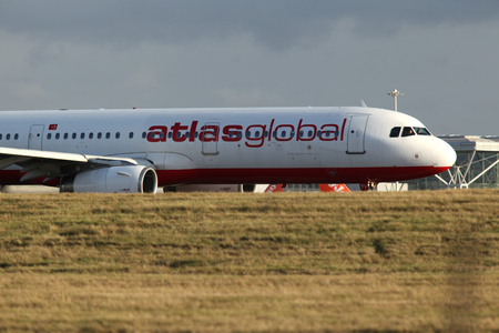 airbus: Atlas Global Airbus A321, TC-ETV, departs London Stansted Airport, Essex