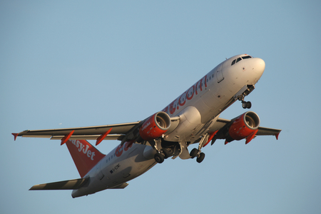 airbus: Easyjet Airbus A320, G-EZWC, departs London Stansted Airport, Essex