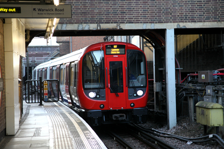 earls court: District line undergound train approaches Earls Court Station, London Editorial
