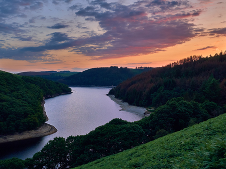 Llyn Brianne Reservoir at Sunset. Built to regulate the flow of the river Towy and situated in the Cambrian Mountains mid Wales it's a popular tourist attraction for hikers, fishermen, mountain bikers, bird watchers and horse riders.
