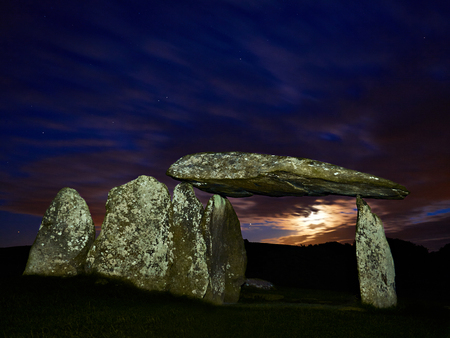 Pentre Ifan Burial Chamber at Moonset. Set in the Preseli Hills and dating back to 3,500 BC it is the largest Neolithic burial chamber in Wales. Part of a larger structure for the ceremonial burial of the dead. Considered spooky at night!