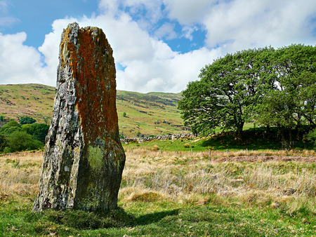 Standing Stone at Coed-y-Bedo. Situated at the head of Cwm Main near Bala Wales the stone is nearly 6 feet tall and one of the largest in the area. Very near an ancient trackway it could have been a boundary stone or way marker.