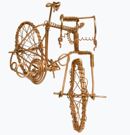 Miniature wire art bicycle made from bronze coloured wire. Stock Photo - 10276405