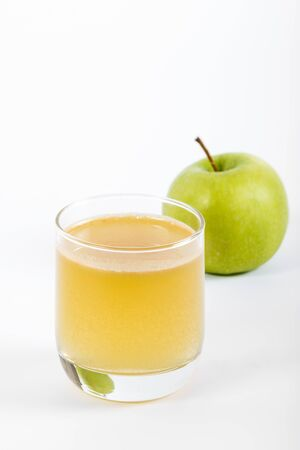 lass: lass of apple juice and green apples isolated on white Stock Photo