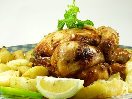 Roast chicken whit potaotes and salad Stock Photo - 489625