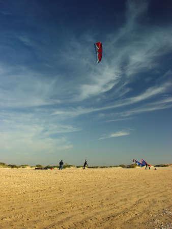 kiter: Kiter fly on beach