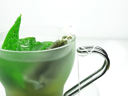 robustness: green tea and mint on cup Stock Photo