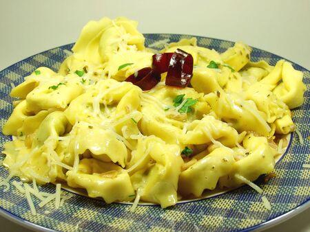 Italian fresh pasta whit garlic and red hot chili pepper photo