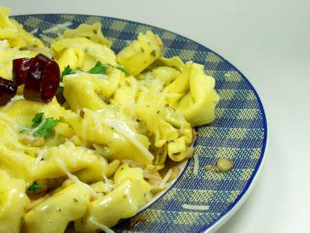 Italian fresh pasta whit garlic and chili photo