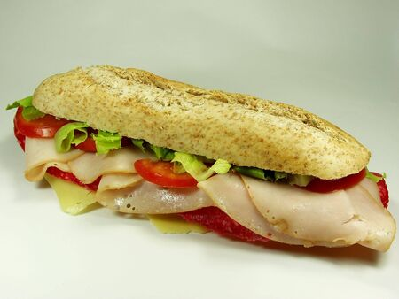 hoagie: salami sandwich on white surface  whit wholemeal bread Stock Photo