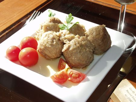 meatballs whit onion sauce and cherry tomatoes photo