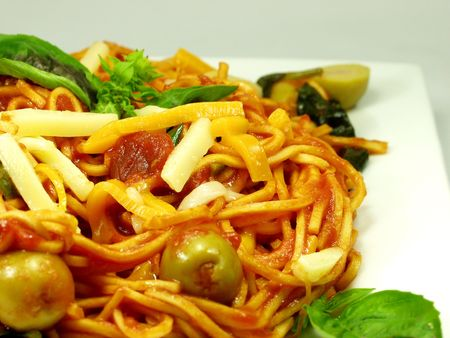 close up of italian pasta, spaghetti whit tomato sauce and cheese
