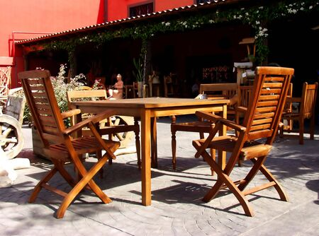terrace forniture on wood made. Table and chairs photo
