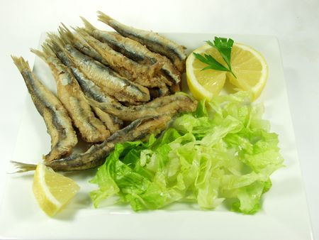 anchovy fish: fried anchovy fish whit salad. andalusian and spanish tapa Stock Photo