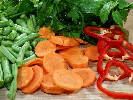 fresh vegetables sliced on wooden table whit herbs Stock Photo - 646803