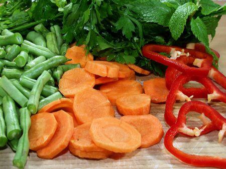 fresh vegetables sliced on wooden table whit herbs Stock Photo - 646803