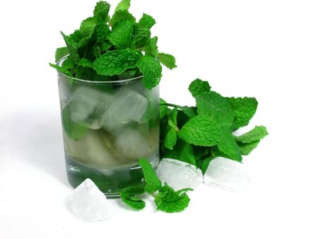 robustness: green tea and mint leaves on ice glass Stock Photo