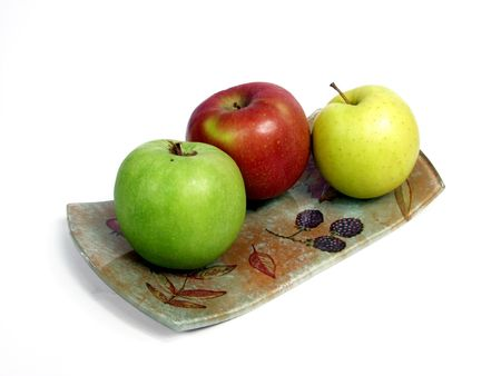 geen: decorated tray with red, geen and yellow apples. Stock Photo