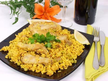 spanish rice style. Paella with chicken, pork, onions, tomato, peas.
