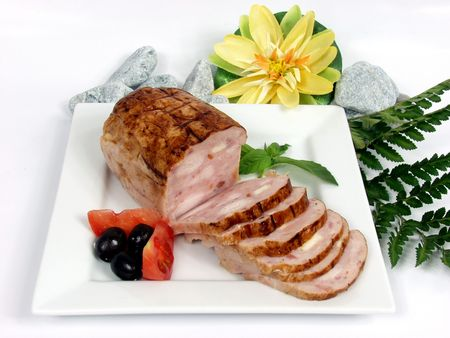 chicken and pork pie with tomato on white platter photo