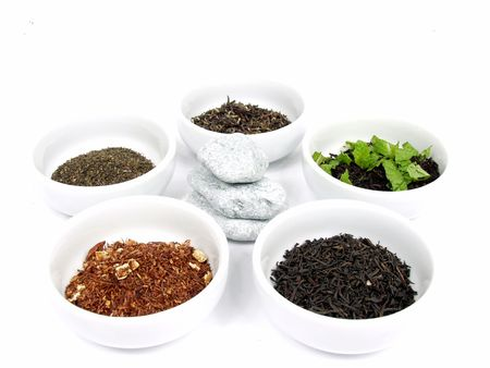 differents types of tea on white bowls Stock Photo