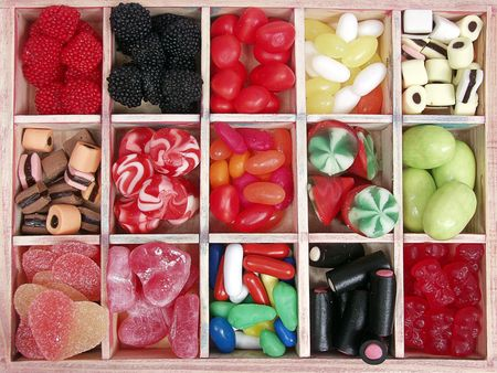 assorted wooden box with colorful sweety candy