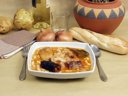 sustenance: spanish tomato sauce beans called fabada with white wine Stock Photo